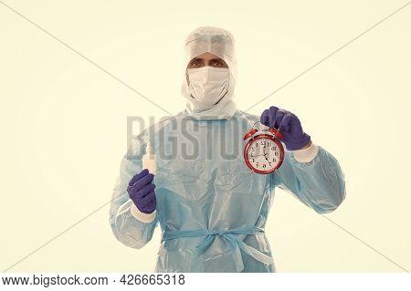 Physician Hold Alarm Clock And Prescribed Covid-19 Medicine For Regular Intake, Reminder