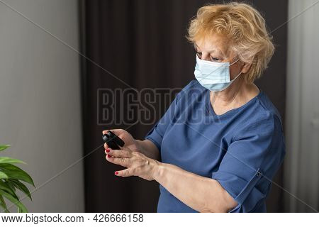 Middle-aged Grey-haired Woman Feels Unwell, Measuring Blood Pressure And Pulse Pulse Rate. Senior Fe
