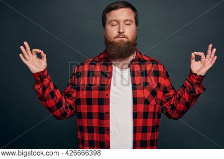 Mindful Patient And Relaxed Young Happy Man, Practice Breathing Exercises, Hold Hands Sideways And S