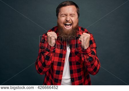 Overjoy, Success And Life Goals Concept. Ecstatic Pleased And Delighted Good-looking Man Scream From