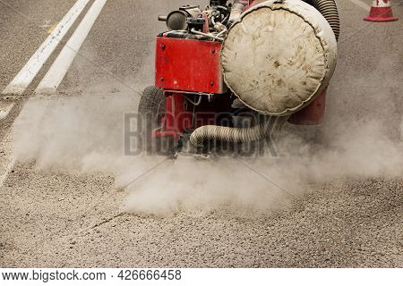 Preparation Of The Surface For Laying Asphalt Pavement. Removal Of Debris And Preparation Of Cracks