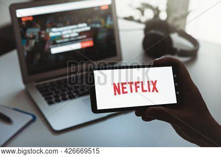 Wroclaw, Poland - Jun 17, 2021: Man With Netflix Logo On Screen. Netflix Is Most Popular Video Strea