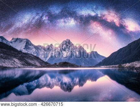 Milky Way Over Snowy Mountains And Lake At Night