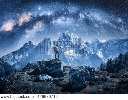 Arched Milky Way And Sporty Woman On The Stone And Mountains