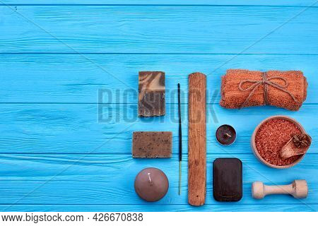Flat Lay Set Of Brown Stuff On Blue Wooden Table.