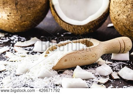 Grated Coconut In Wooden Measuring Spoon, Sliced coconut Portion, Candy Ingredient