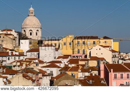 Lisbon, Portugal - February 16, 2017: Aerial View Of Alfama Neighborhood An Red Roofs Since Portas D