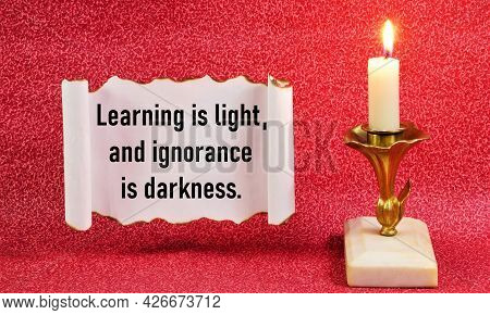 Learning Is Light, And Ignorance Is Darkness. The Text Of A Wise Thought On A Vintage Scroll.