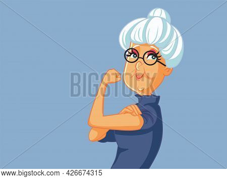 Strong And Healthy Senior Woman Flexing Muscles