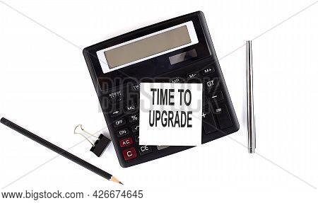 Time To Upgrade Text On Sticker On Calculator With Pen,pencil On White Background