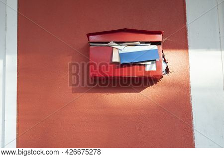 Red Mailbox With Documents Overflowing, Mailbox Hasn't Been Opened For A Long Time, Red Mailboxes On