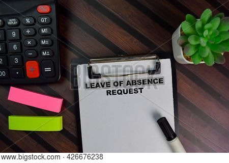 Leave Of Absence Request Write On A Paperwork Isolated On Wooden Table.