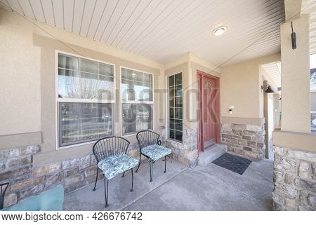 Front Porch Exterior With Two Chairs And Stone Sidings