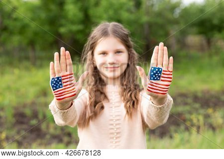 Cute Little Child Girl With Painted Hands In American Flag Color, Focus On Hands. Usa Celebrate 4th