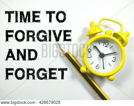Business Concept.text Time To Forgive And Forget  With Alarm Clock And Pencil On White Background.