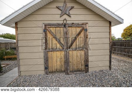 Tool Shed With Worn Out Wood Outline And Star Decor Creating A Rustic Design
