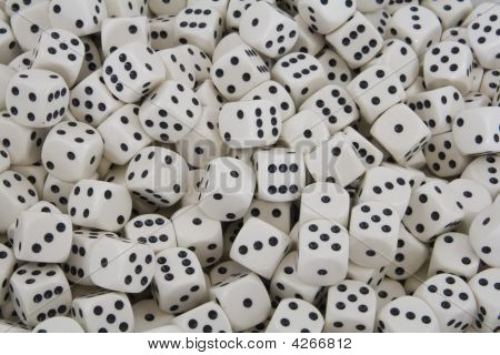 Multiple White Dice With Black Spots
