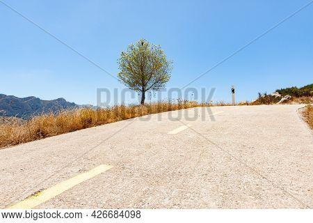 Road Through Coll De Rates Uphill Information Road Winding Through Mountains Toward To Rock Outcrop