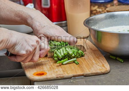 Chef Cuts Asparagus With Knife To Make Baked Goods With Asparagus And Peas. Step By Step Recipe.