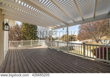 Terrace Of A House With Pergola Roof And Wood Planks Flooring