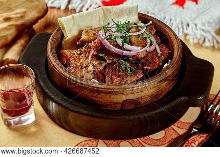 Grilled Pork Shashlik On Lavash With Fresh Onions And Greens