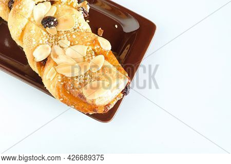 Breads With A Golden Crust On Background.