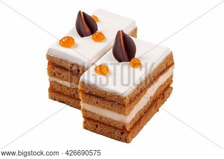 Two Slices Of Cake With Jam, Cream Cheese Buttercream And Sugar Icing
