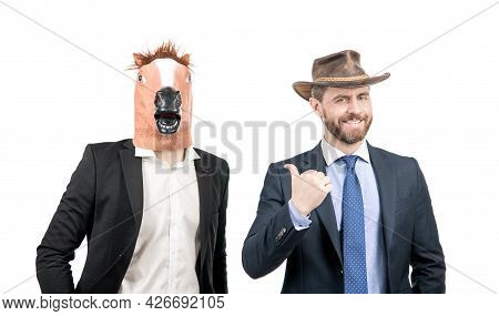 Happy Man Point Finger At Weird Businessman Wearing Horse Head Mask In Formalwear, Western Party