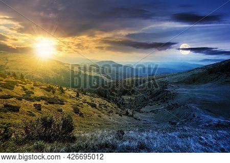 Day And Night Time Change Concept Above Carpathian Mountain Landscape. Beatiful Scenery With Green R