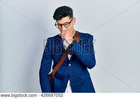 Young hispanic man wearing business clothes feeling unwell and coughing as symptom for cold or bronchitis. health care concept.