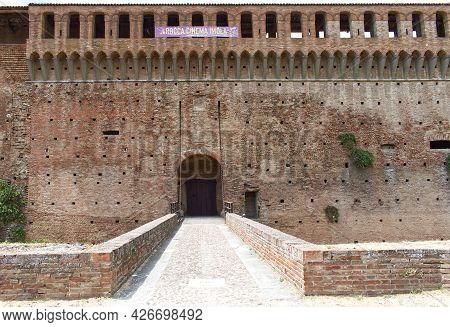 Main Entrance With Drawbridge Of The Castle Of Imola. Banner Of Rocca Cinema Imola (fortress Cinema