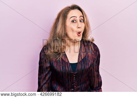 Middle age caucasian woman wearing casual clothes scared and amazed with open mouth for surprise, disbelief face