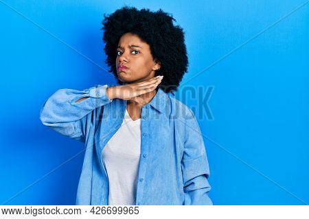 Young african american woman wearing casual clothes cutting throat with hand as knife, threaten aggression with furious violence