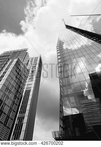 LONDON, UK - 12th July 2021: Modern glass office towers including the shard building in central London. Taken in black and White.