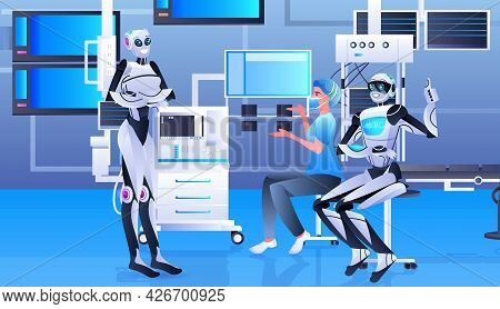 Female Doctor Surgeon In Protective Mask Working With Robots In Clinic Surgery Room Medicine Healthc