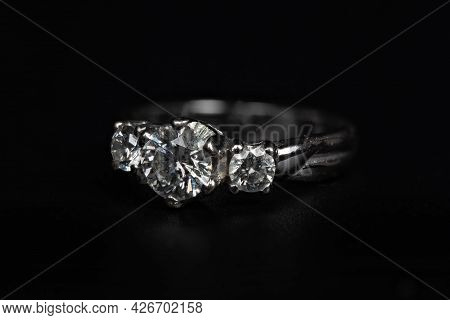 Close Up Silver Diamond Ring Isolated On Black Background