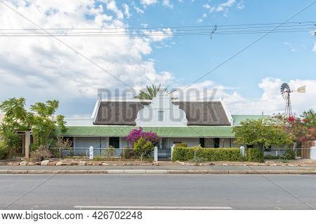 Prince Albert, South Africa - April 20, 2021: A Panoramic Street Scene, With Houses, In Prince Alber