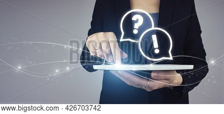 Faq Frequently Asked Questions Concept. White Tablet In Businesswoman Hand With Digital Hologram Faq