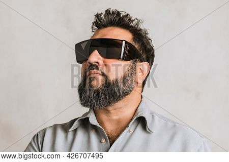 Blind Indian man wearing black safety goggles