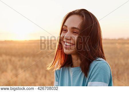 Summer Portrait Of Laughing Happy Woman Outdoor, Enjoying Warm Sunshine, Wearing Blue T Shirt, Havin