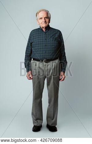 Happy senior man in a tartan scott shirt