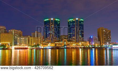 Dubai, UAE - January 29, 2020: The Creek and Deira in Dubai city at night, United Arab Emirates