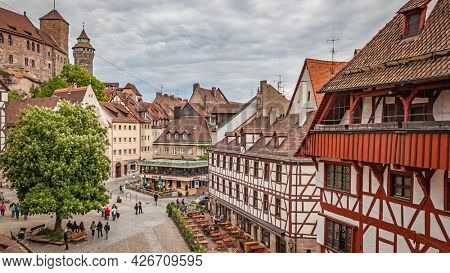 Nuremberg, Germany - May 17, 2016:  Panoramic view the old town of Nuremberg.  German cityscape on cloudy day