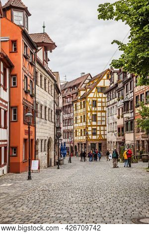 Nuremberg, Germany - May 17, 2016:  Street in the old town of Nuremberg with walking tourists