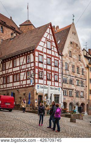 Nuremberg, Germany - May 17, 2016:  Street in the old town of Nuremberg with walking people