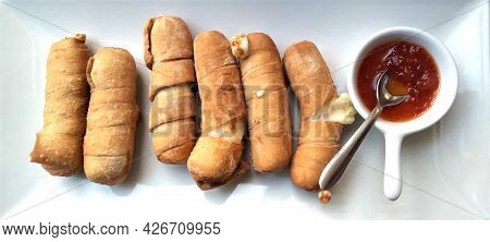 Cheese Sticks With Pepper Sauce - Tequeños Authentic Original Venezuelan Appetizer Made Of Fried Cor