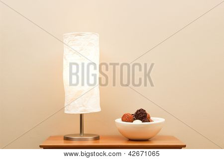 Lamp And Bowl On Small Table