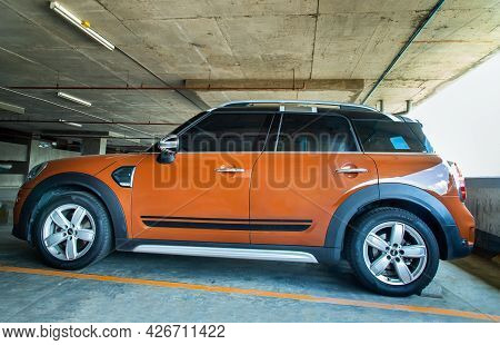 Bangkok, Thailand - 30 Jun 2021 : Side View Of Beautiful Shiny Brown Mini Cooper Parked In The Parki