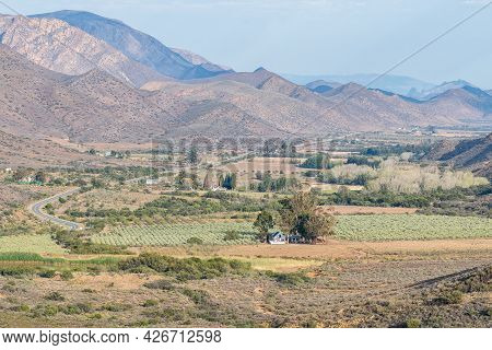 The View From The Kredouw Pass On Road R407 Into The Prince Albert Valley. The Swartberg Mountains A