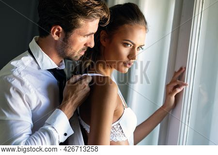 Romantic Couple Being Intimate And Sensual In Bedroom